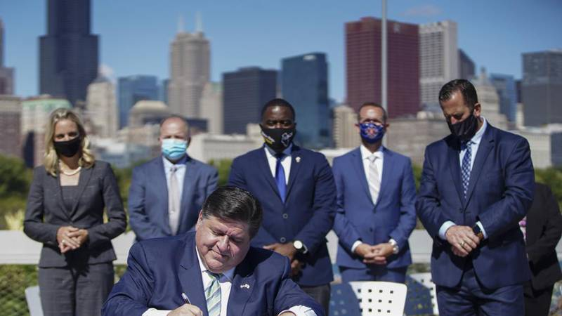 Gov. J.B. Pritzker signs that state's Climate and Equitable Jobs Act at Shedd Aquarium in...