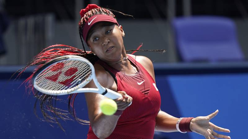 Naomi Osaka, of Japan, plays against Zheng Saisai, of China, during the first round of the...