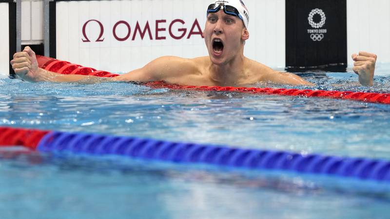 Chase Kalisz, of the United States, celebrates winning the final of the men's 400-meter...