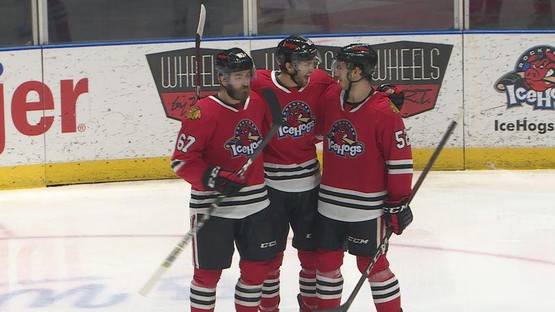 Blackhawks prospect Josiah Slavin celebrates after scoring his first professional goal for the...