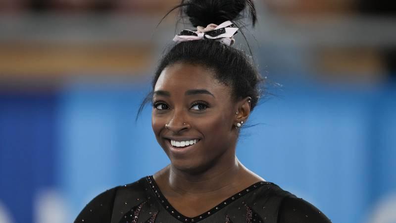 Simone Biles of the United States smiles as she trains for artistic gymnastics at Ariake...