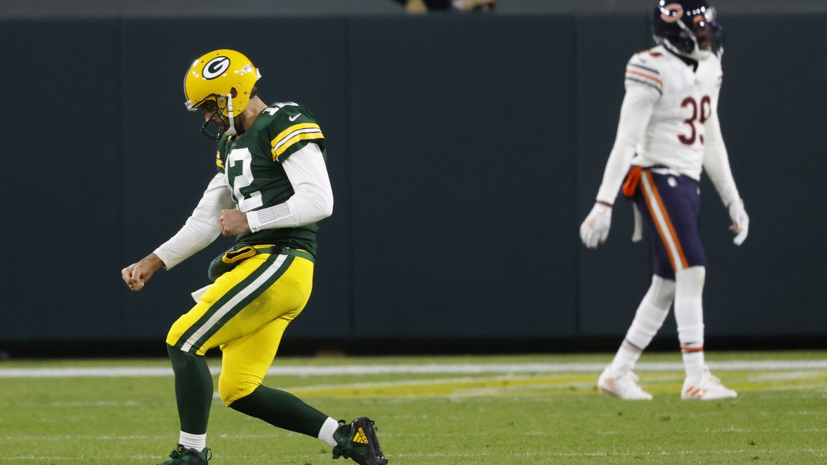 Green Bay Packers quarterback Aaron Rodgers (12) reacts after throwing a touchdown pass against...