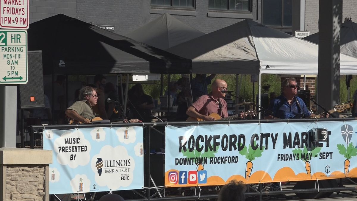 Rockford Residents rock out at city market Friday evening enjoying live music once again.