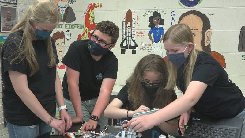 Olivia Carlson, Brayden Beck, Cora Whiteman, and Aubrey Carlson are the four members of the...