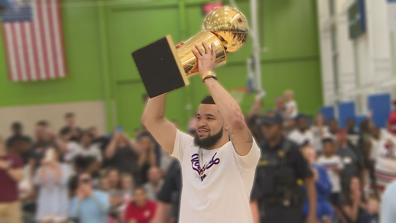 Fred VanVleet lifts Larry O'Brien trophy over his head at 2019 FVV Fan Fest.